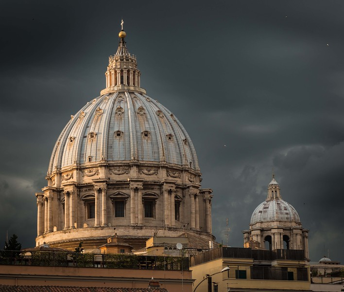 While walking to dinner.  Just before it started to rain.  Birds circling around the Basilica Dome.