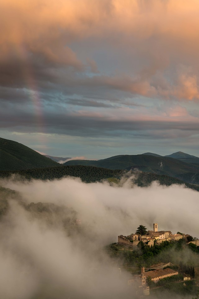 Was raining most of afternoon, then it cleared and this fog bank rolled in just as the sun was setting.  It threw in a rainbow for a nice finishing touch.  Ahhh, Italy.