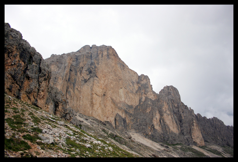 This is the huge face of Rotwand Roda de Vael. I stared at this face for a long time sometimes my mind was soloing the face with a rope and gear, sometimes I didn't have anything and was free on the face without fear. The route I would be climbing was around the backside.