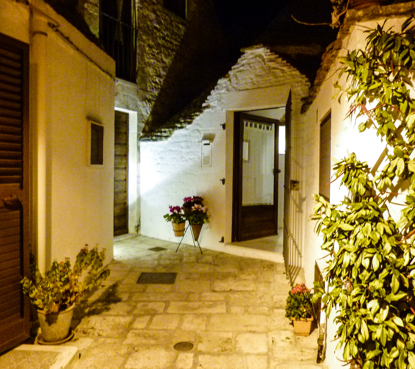 Boomer travel - Italy - stay in a Trulli house when you visit Alberobello. Click through to learn about our favorite places to stay Italy. Perfect for your next boomer trip to Italy.