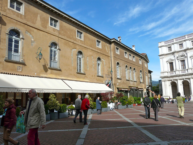 On a walking tour of Bergamo, Italy, enjoy the sights of Piazza Vecchia.