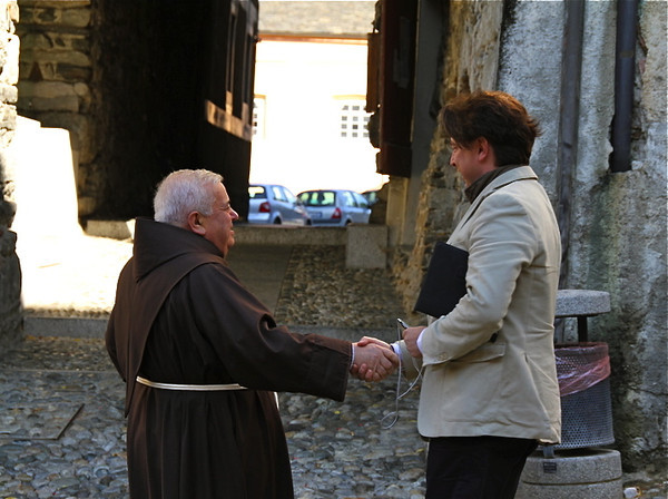 The parish priest saying hello in Orta San Giulio.