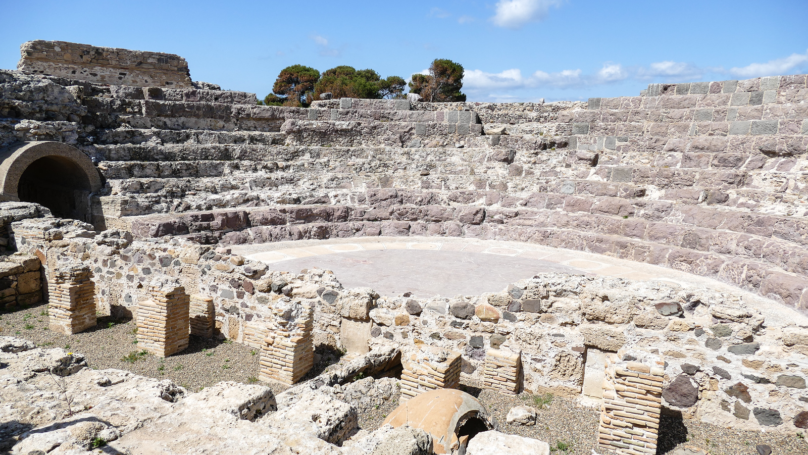 Explore the Roman amphitheater in Nora on a Mediterranean cruise excursion. #italy #cruise #history