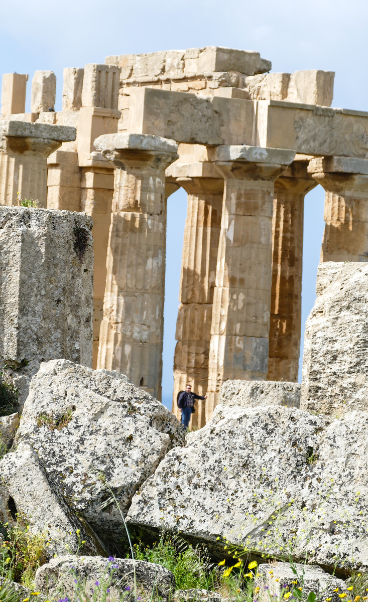 A visitor adds scale to the immense columns and stone blocks at Selinunte in Sicily.