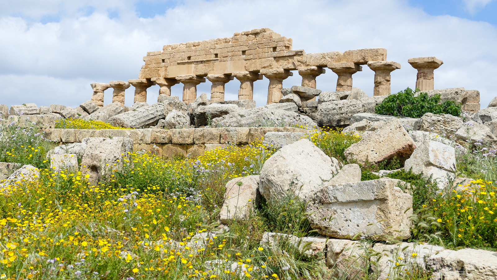 Only a small portion of the Temple of Apollo remains standing in Selinunte, Sicily. it's a site worth seeing on a cruise excursion from Trapani.