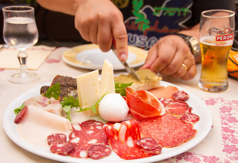 A delicious antipasti for lunch in Subiaco, Italy. Food is part of the travel fun on a boomer vacation in Italy. #antipasto #Italy #food