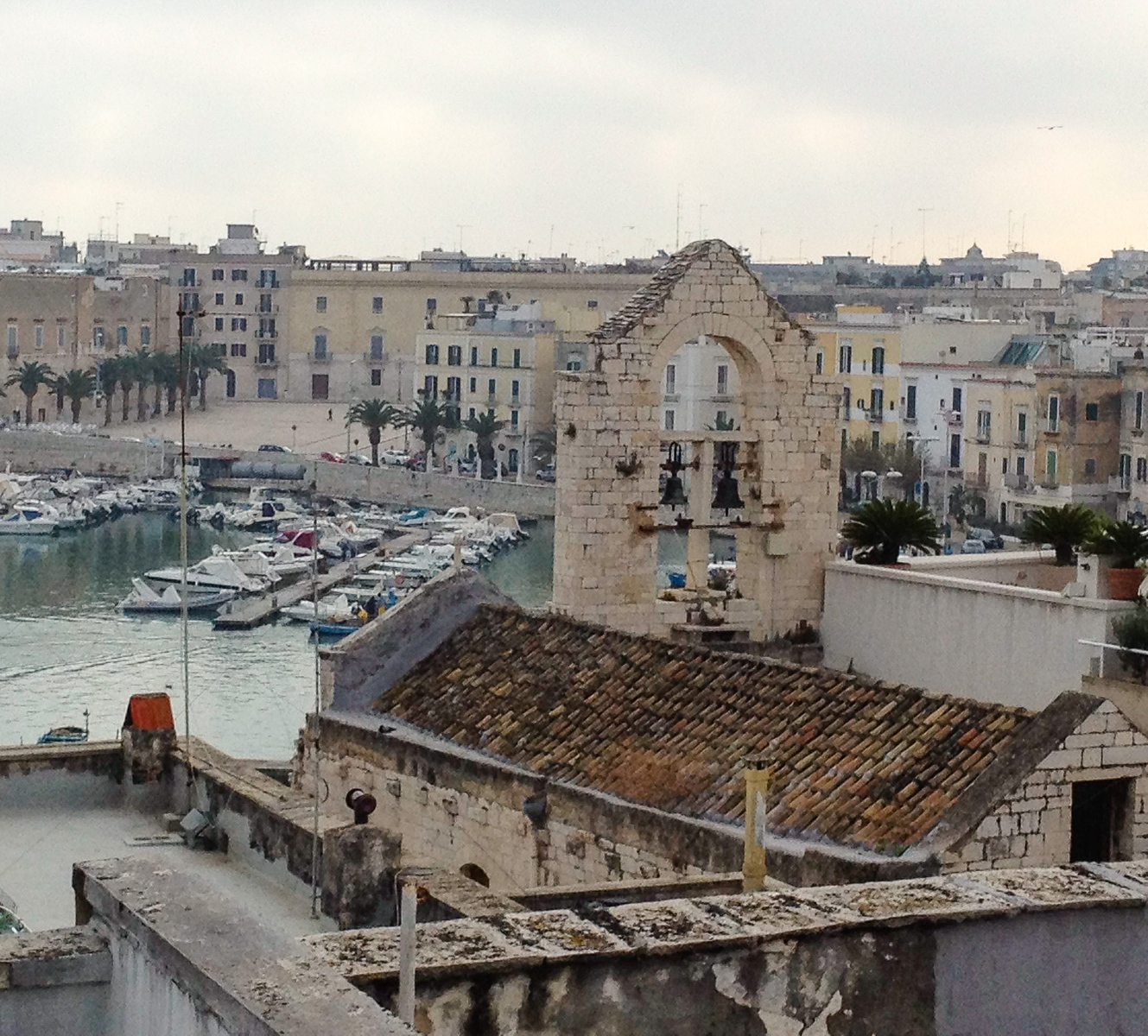 Boomer travel - Italy - in Trani, stay at the B&B Palazzo Paciotti. Click through to read more of our favorite places to stay in Italy. Then plan your boomer vacation.