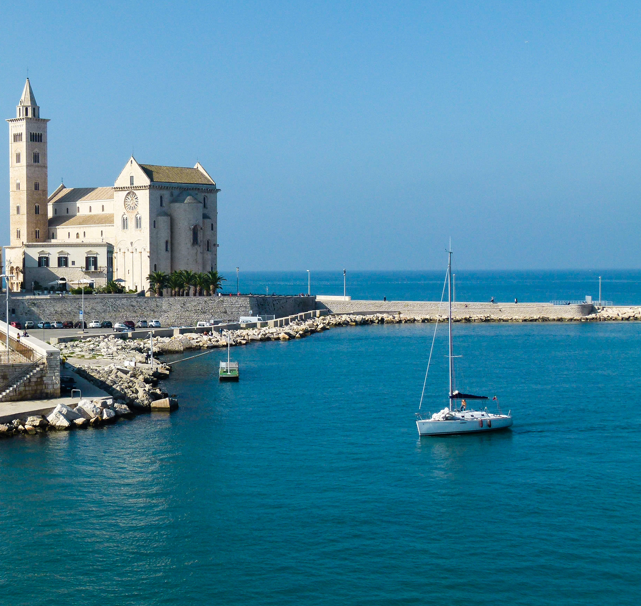 The cathedral sits next to the harbor in Trani, Italy. Be sure to include Trani on a boomer road trip in southern Italy. #vacation #roadtrip #Italy