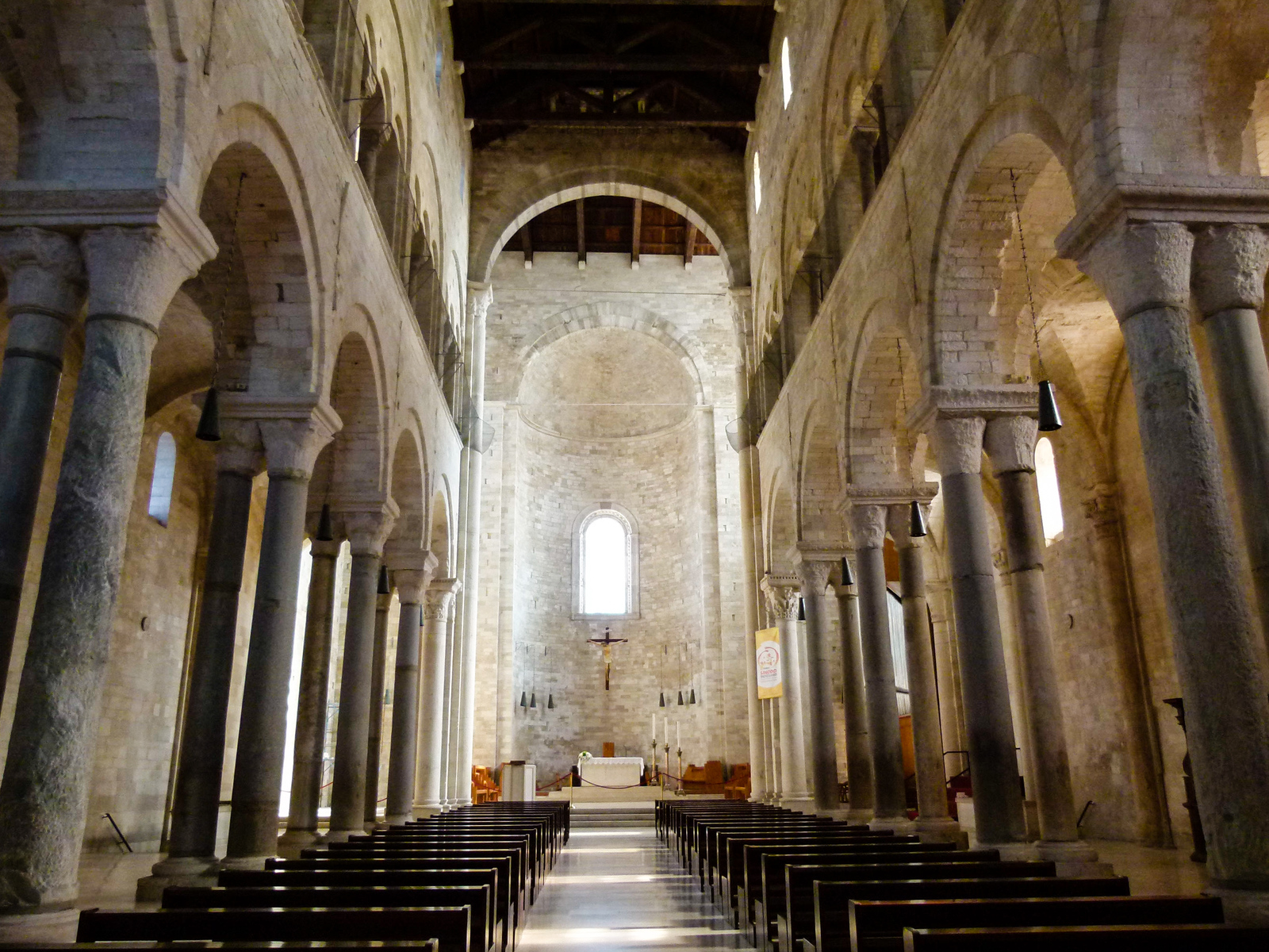 The simple,but elegant, interior of the Trani Cathedral. Be sure to include it when you visit Trani, Italy. #boomertravel #Trani #Italy