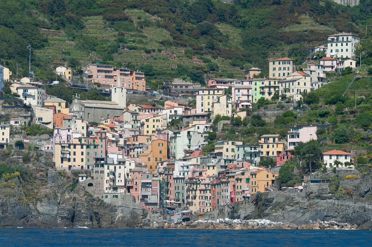 Riomaggiore houses on a valley in Cinque Terre, Italy