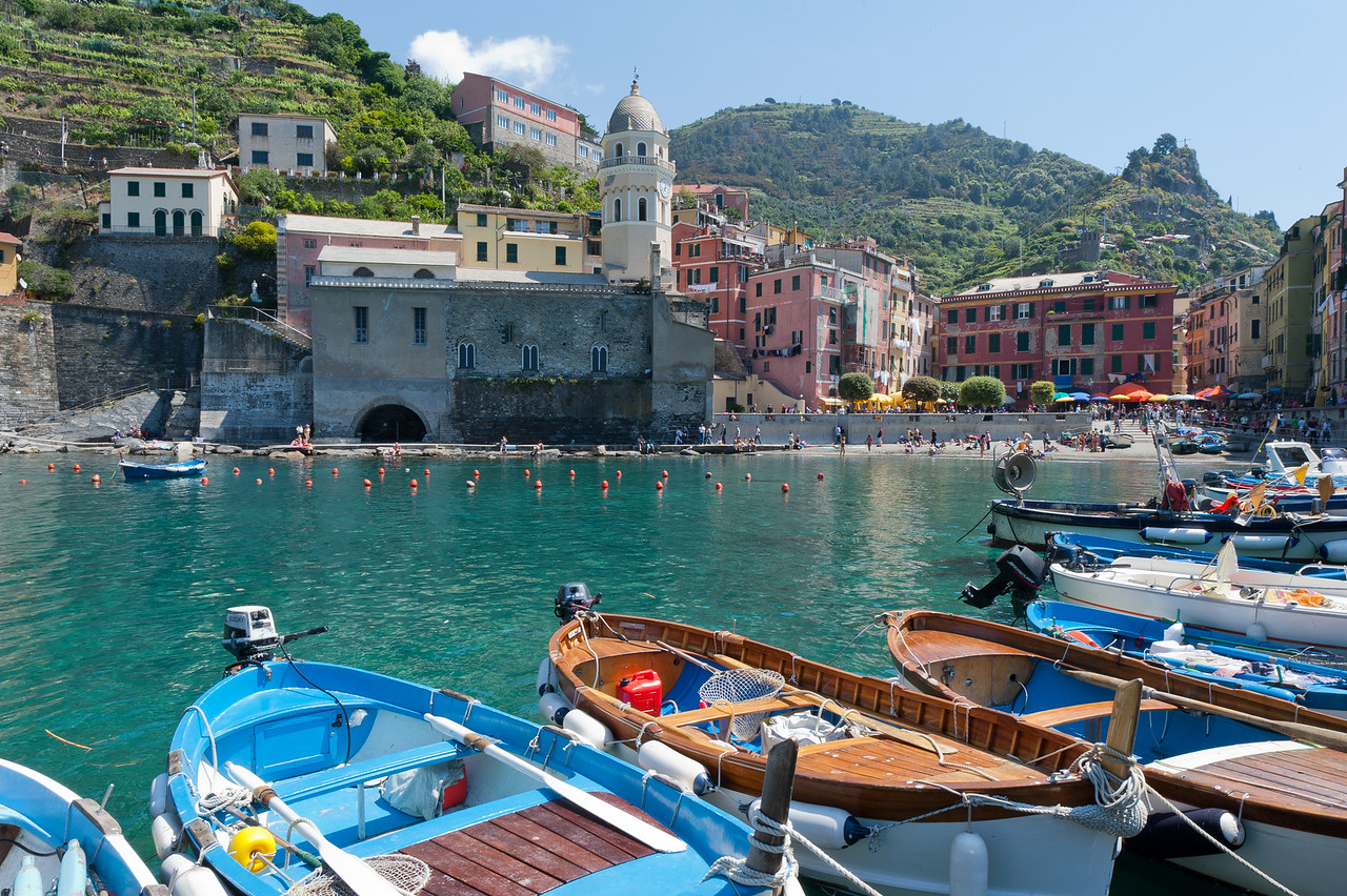 Wide shot of the Vernazza Harbor with view of boats and buildings - Cinque Terre, Italy
