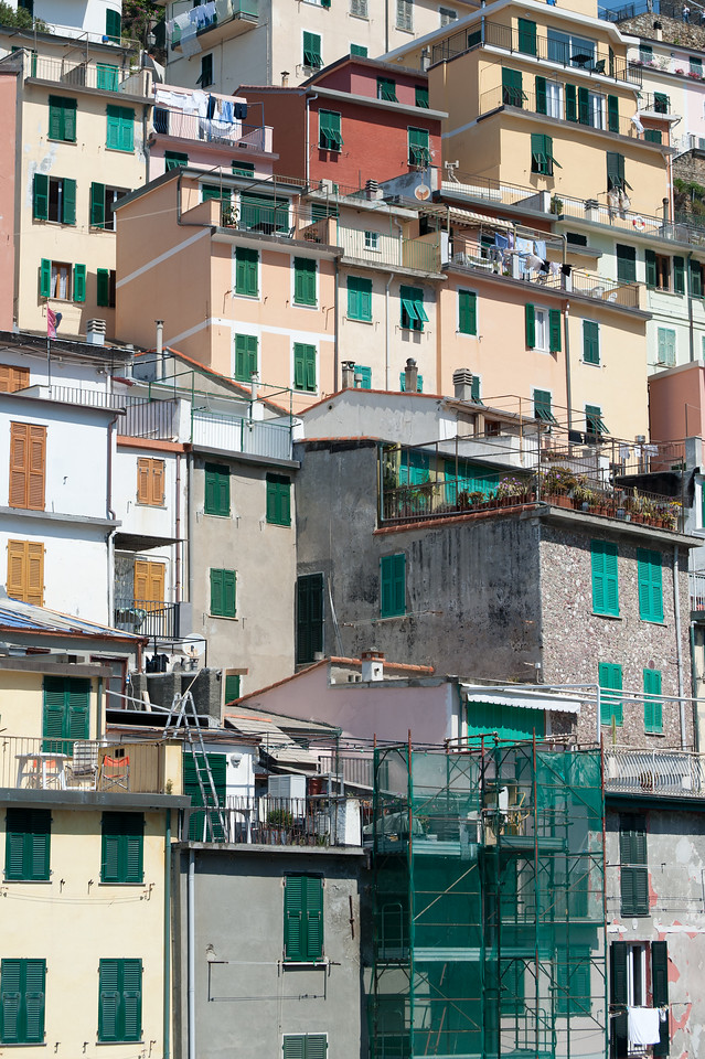 Tall buildings on a hill at Cinque Terre, Italy