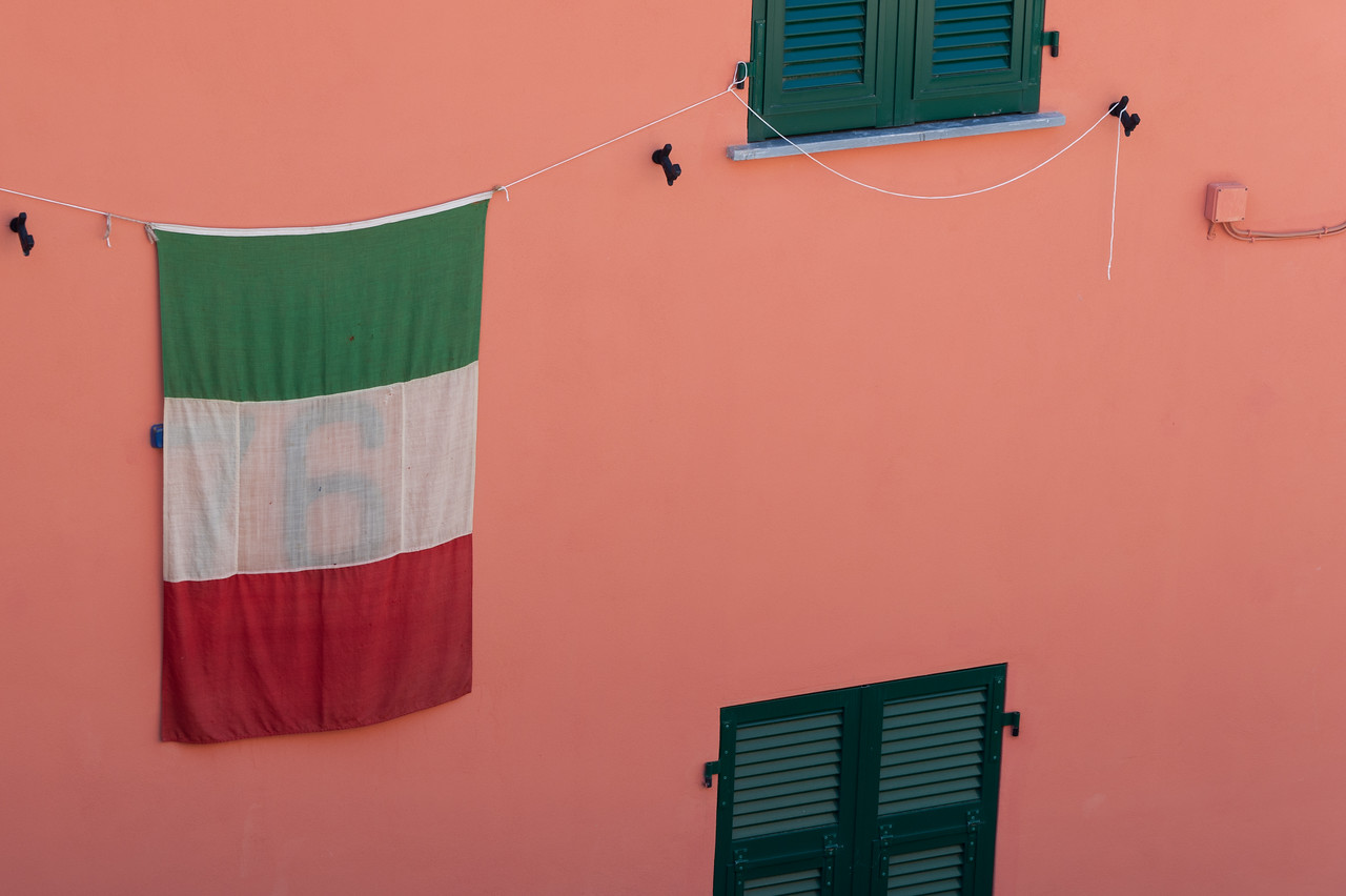 Italian flag hanging on a wall in Cinque Terre, Italy
