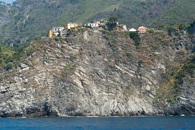 Houses atop a rocky cliff in Cinque Terre, Italy