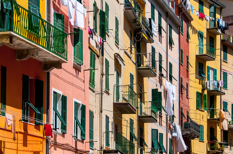 Shot of balconies and windows from buildings in Cinque Terre, Italy