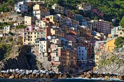 Breathtaking view on Riomaggiore from the boat. The warm and pleasing light of the end of the day helps to beautify the capture.