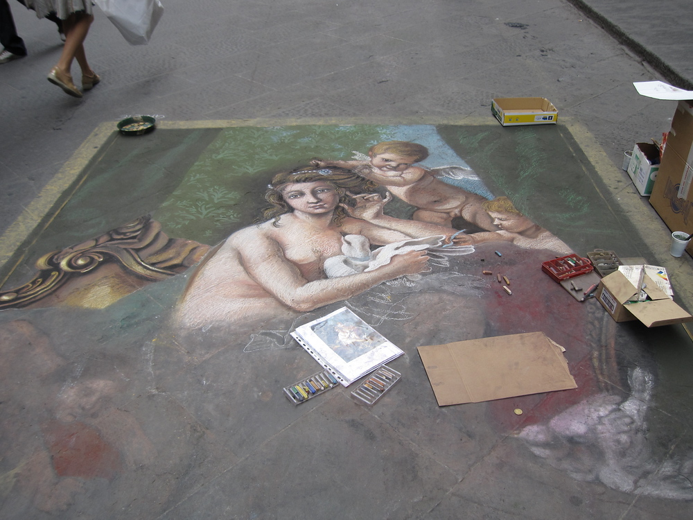 Chalk Art in process on a Sidewalk of Florence, Italy