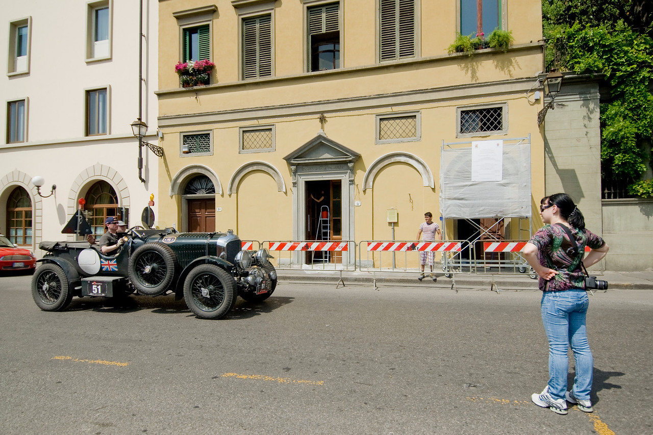 Military vehicle driving down the street of Florence, Italy