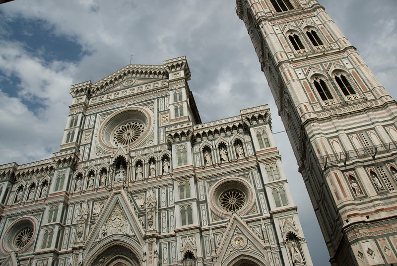 Looking up the facade of Florence Cathedral and Giotto's bell tower - Florence, Italy