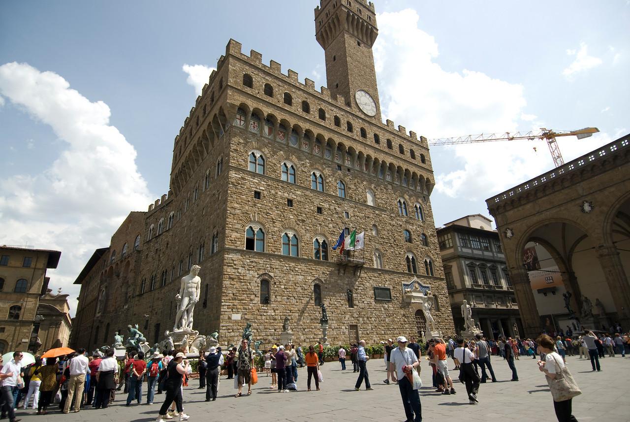 Street scene in front of Palazzo Vecchio in Piazza della Signoria - Florence, Italy