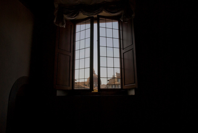 Looking out the window with a view of Florence Cathedral dome - Florence, Italy