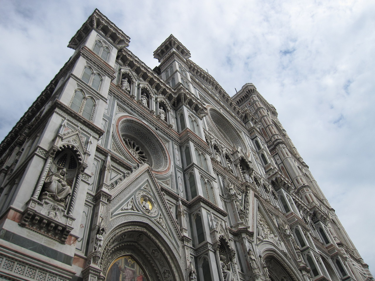 Looking up the facade of Florence Cathedral in Florence, Italy