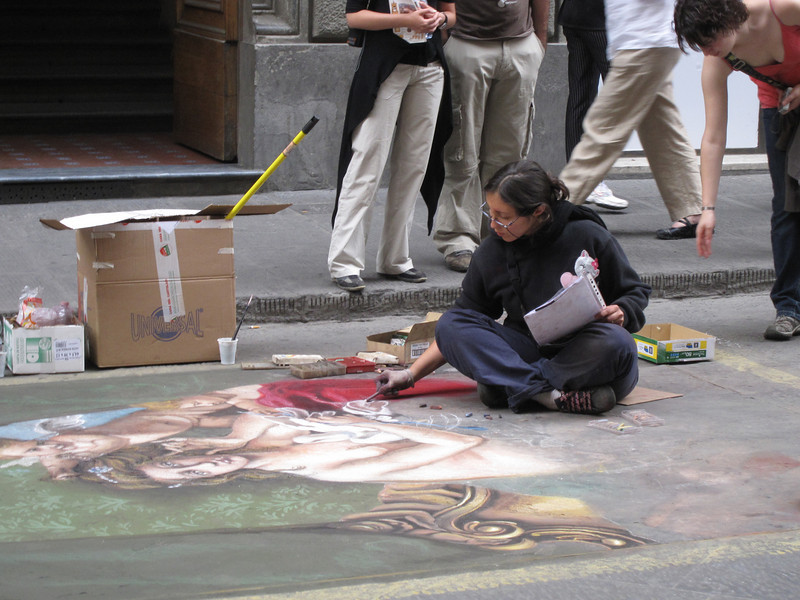 Woman painting on the streets of Florence, Italy