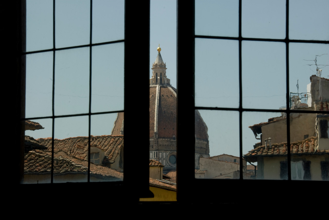View of the Florence Cathedral dome through a window - Florence, Italy