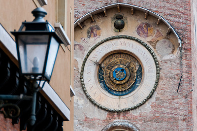Detail of medieval clock tower in Piazza delle Erbe - Mantova, Italy