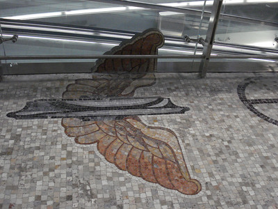 Milano Centrale train station winged wheel mosaic, Milan - Italy.