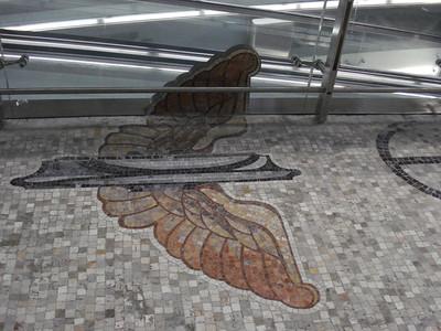 Milano Centrale train station winged wheel mosaic, Milan - Italy.