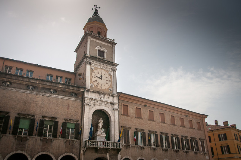 Grand clock at the city hall building in Piazza Grande in Modena, Italy