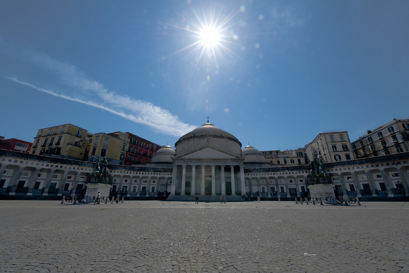 Large square outside Basilica of San Paolo Maggiore in Naples, Italy