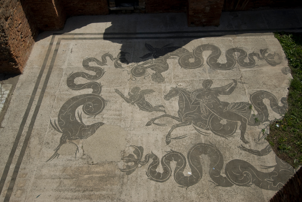 Ancient floor mosaic in Roman port of Ostia Antica, Italy