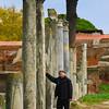 Italy, Ostia Antica, Visitor Admiring Columns