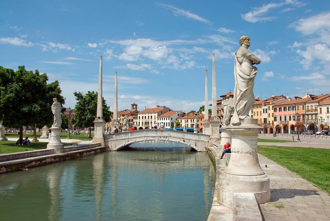 Sculptures and bridge at Prato della Valle in Padua, Italy