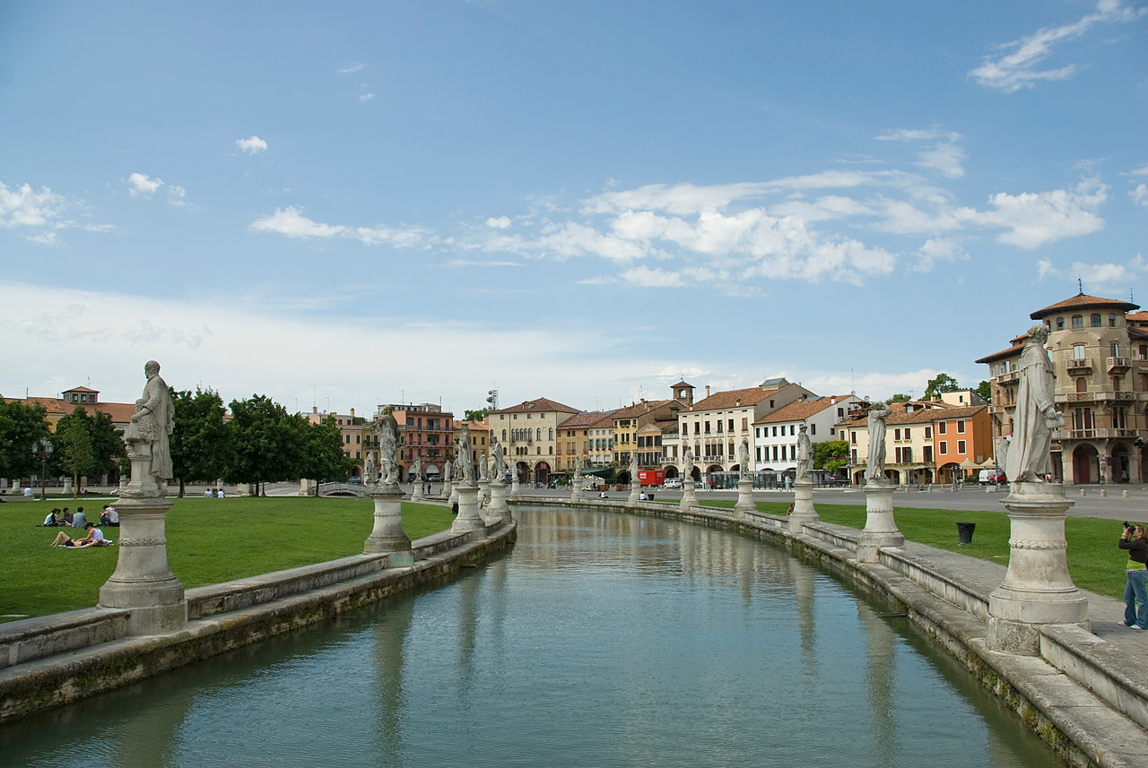 Wide shot of the canal and statues at Prato Della Valle in Padua, Italy