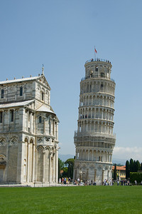 The Leaning Tower of Pisa next to the Cathedral of Pisa - Italy