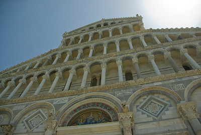 Looking up the facade of the Cathedral of Pisa in Italy