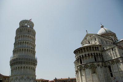 Leaning Tower of Pisa casting a shadow over Cathedral of Pisa - Italy