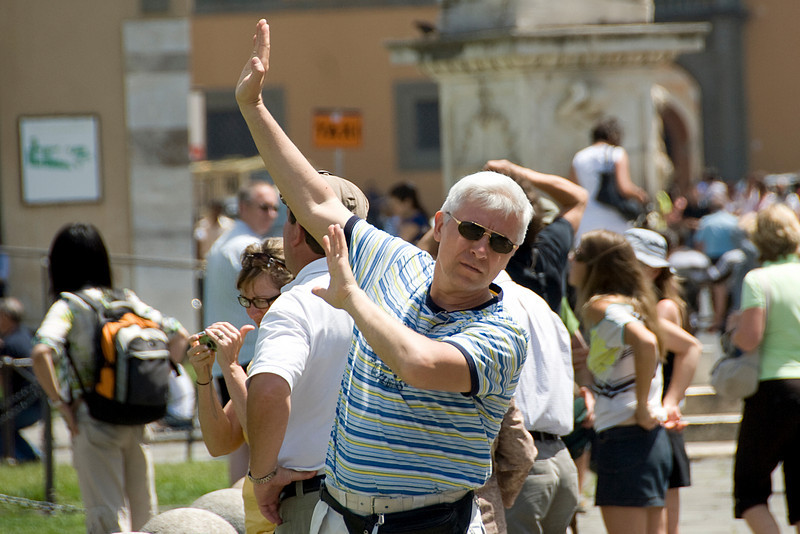 Tourists near the Leaning Tower of Pisa in Italy