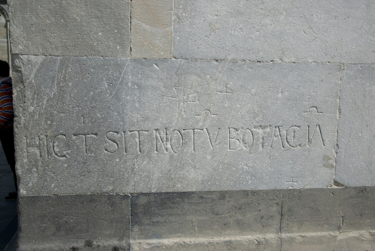 Writings on the brick wall of the Cathedral of Pisa - Italy