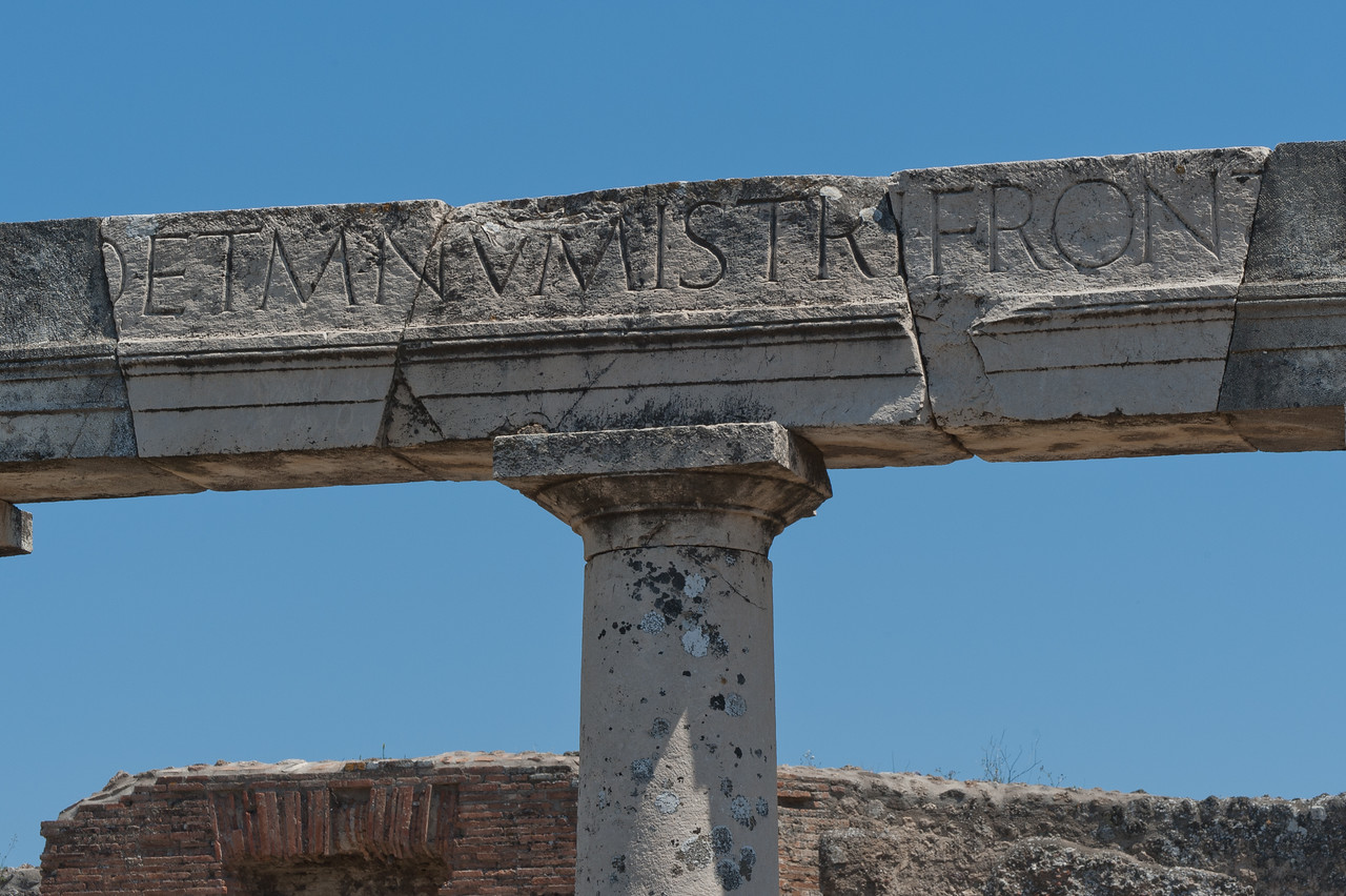 Writings on top of a pillar in Pompeii, Italy
