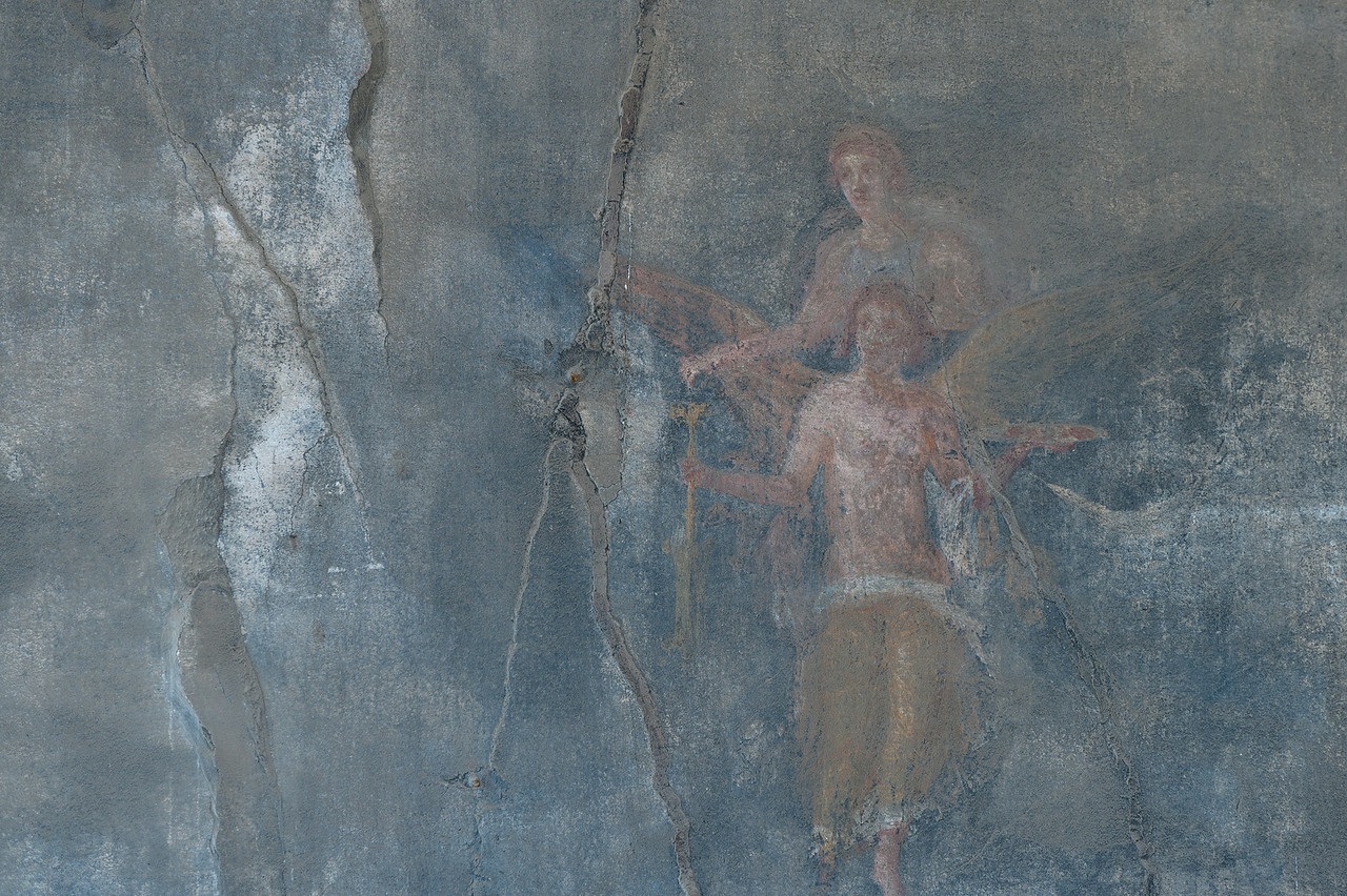 Mural on a dilapidated wall in Pompeii, Italy