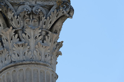 Architectural details on a pillar in Pompeii, Italy