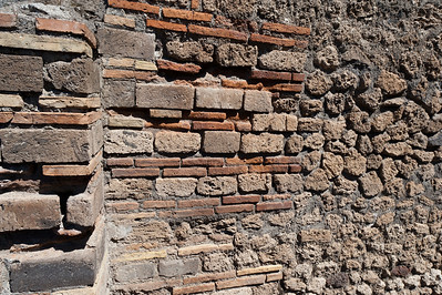 Close-up shot of stone and brick walls in Pompeii, Italy