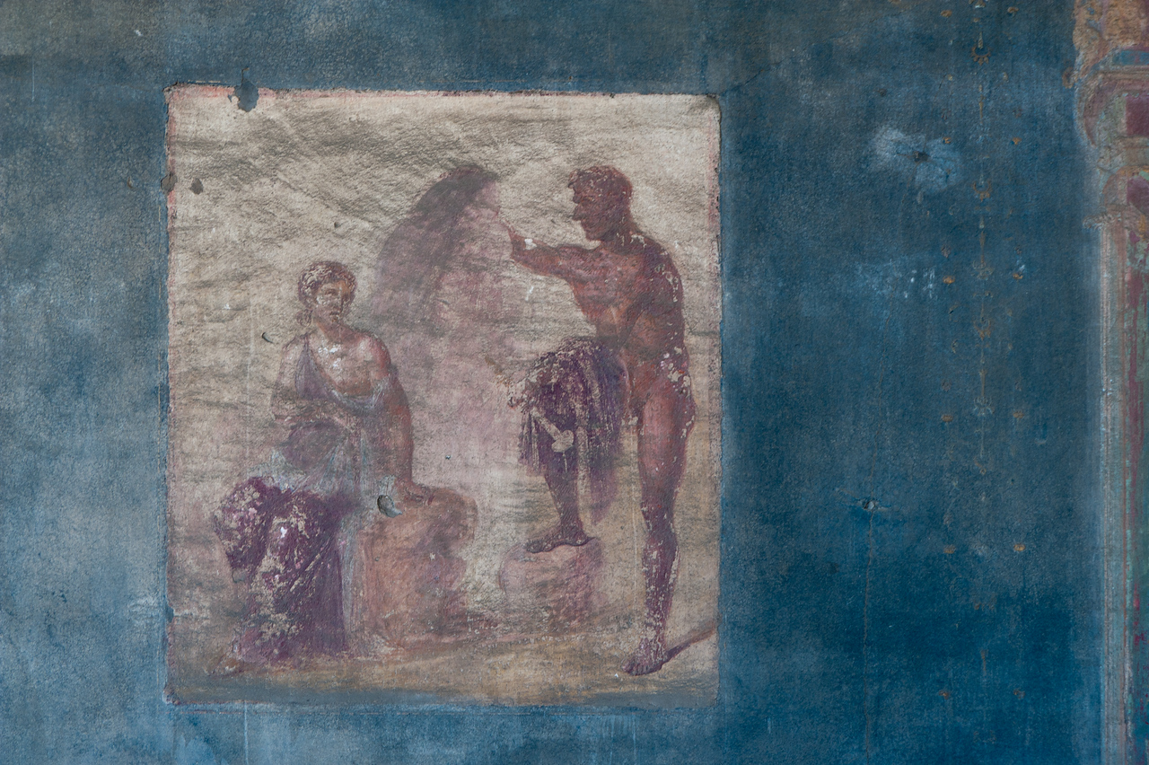 Closer shot of painting on the wall spotted in Pompeii, Italy