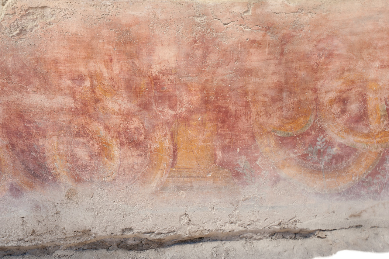 Art painting on the walls in Pompeii, Italy