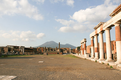 Main plaza with Mount Vesuvius in the background.  Ancient ruins of Pompeii, Italy