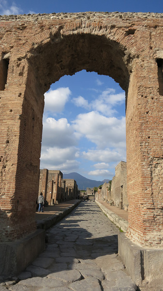 Archway with Mount Vesuvius in the background.  Ancient ruins of Pompeii, Italy